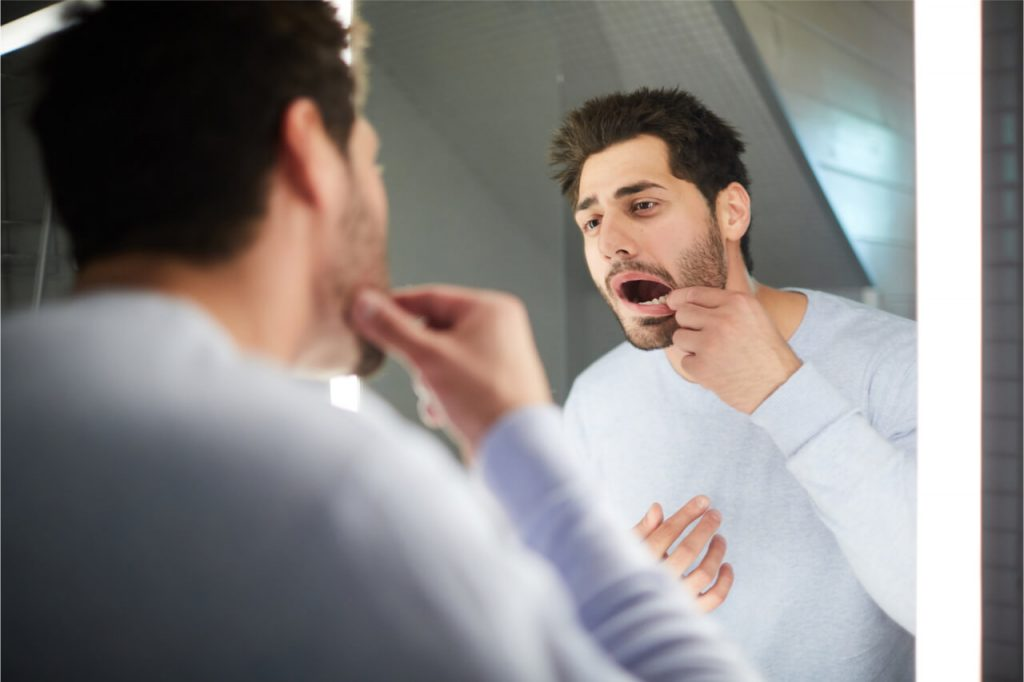checking mouth health